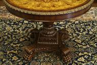 carved edging around the table is gold accents