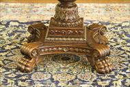 Antique reproduction empire center table with paw feet