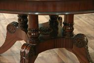 Traditional dining room table pictured in mahogany finish