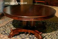 60 Round to 120 oval mahogany table with solid pedestal platform base.
