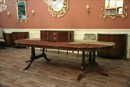 Round to Oval mahogany dining table with three leaves and seats 10 - 12 people