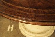 54 Round rustic table with large antiqued base.