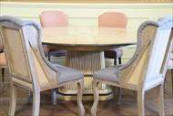 casusal round dining table with peach and blue chairs