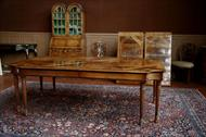 Neoclassical walnut dining table