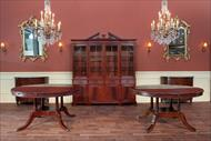 Traditional round dining tables shown side by side for color comparison