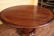 64 round casual, lightly distressed mahogany dining table