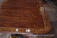 Mahogany dining table with banding