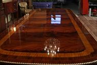 Burnished razor thin lacquer finish captures light and makes this a stately dining table