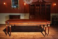 Red mahogany finished Neoclassical dining table