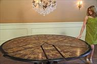 Expandable round dining table shown at 84 inches