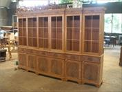 Large unfinsihed china cabinet or hutch shown in Indonesia where cabinet was built.