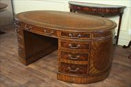 This leather top oval walnut partners desk is perfect for the high end home or office.