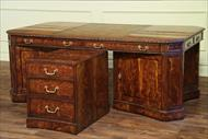 High end leather top partners desk with versatile removable file cabinet/privacy panel.