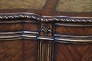 Fleur Des LIs and rope turn carvings around desk