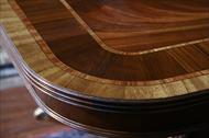Corner details on a 16 foot straight end mahogany dining table