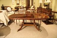 Antique reproduction table with brass mountings and intricate inays