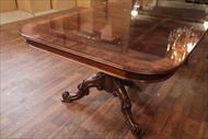 Mahogany dining table with blonde banding, reeded edge and mahogany apron