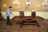 Mahogany dining table with self storing leaves