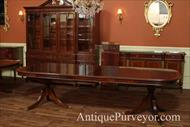 Mahogany dining table with 2 extensions in place.