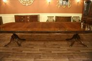 Large dining room table with 3 leaves opens to 13 feet and sits 14-16 people