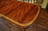 Brilliant colors of natural mahogany. Here is a high end flame mahogany dining table seats 12 to 14.