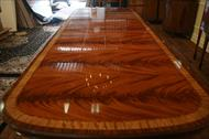 Mahogany dining table with extensions easily seats 12 to 14 people.