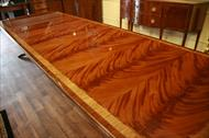 Extra large fine mahogany dining table with extensions. Seats 14 people. Banded flame mahogany table