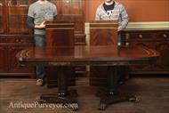 Mahogany dining table with 2 leaves or extensions