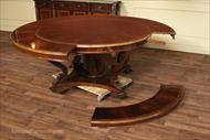 Apron or skirts shown on this model round perimeter table made from mahogany solids.