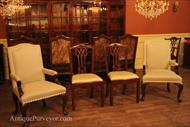 These arm chairs will coordinate with a large variety of antique reproduction dining chairs