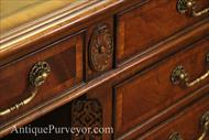 Mahogany executive desk with detailed carving and leather top.