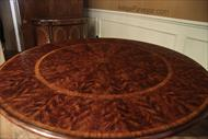 Antique reproduction round mahogany pedestal table