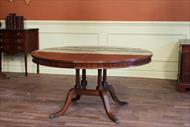 60 Round dining table expands to larger oval.