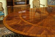 Round to Oval Round Mahogany Dining Table