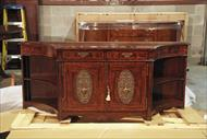 Serpentine side cabinet