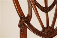 Mahogany shield back dining chairs, swag details