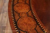 Transitional mahogany and walnut burl table with detailed marquetry.