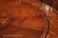 Pie cut swirl mahogany with straight grain mahogany banding