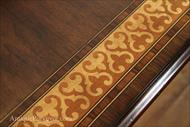 Marquetry details and banded satinwood on cathedral walnut