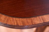 Duncan Phyfe style mahogany dining table with double pedestal base
