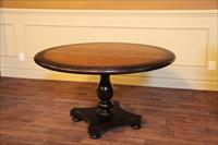 Distressed and antiqued pine and sable round table