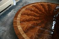 Fine 72 inch round mahogany table with banding and customizable base.