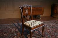 Solid mahogany dining chairs with client provided fabrics.