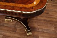 American Empire or Regency style scallop corner dining table with gold leaf accents