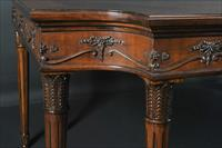 Corner details on a French dining table with carved Neoclassical swags