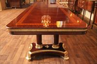 Designer dining table on Regency style pedestals and gold leaf accents, designed by AntiquePurveyor