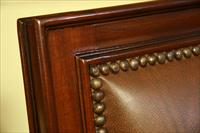 Leather upholstered mahogany dining chairs with brass nail trim