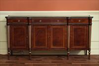 Gold leaf accented mahogany sideboard