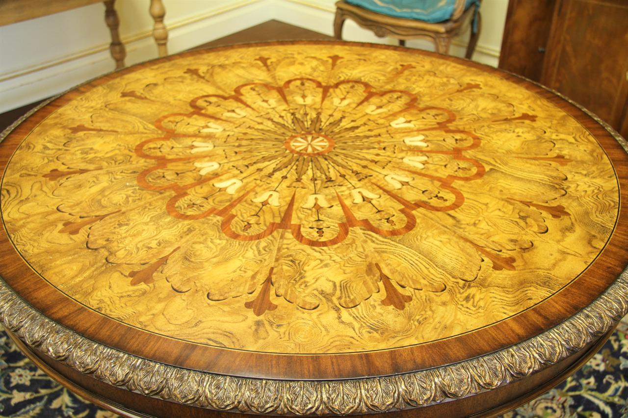 42 Inch Round Mahogany And Walnut Center Table With Lion Paw Feet