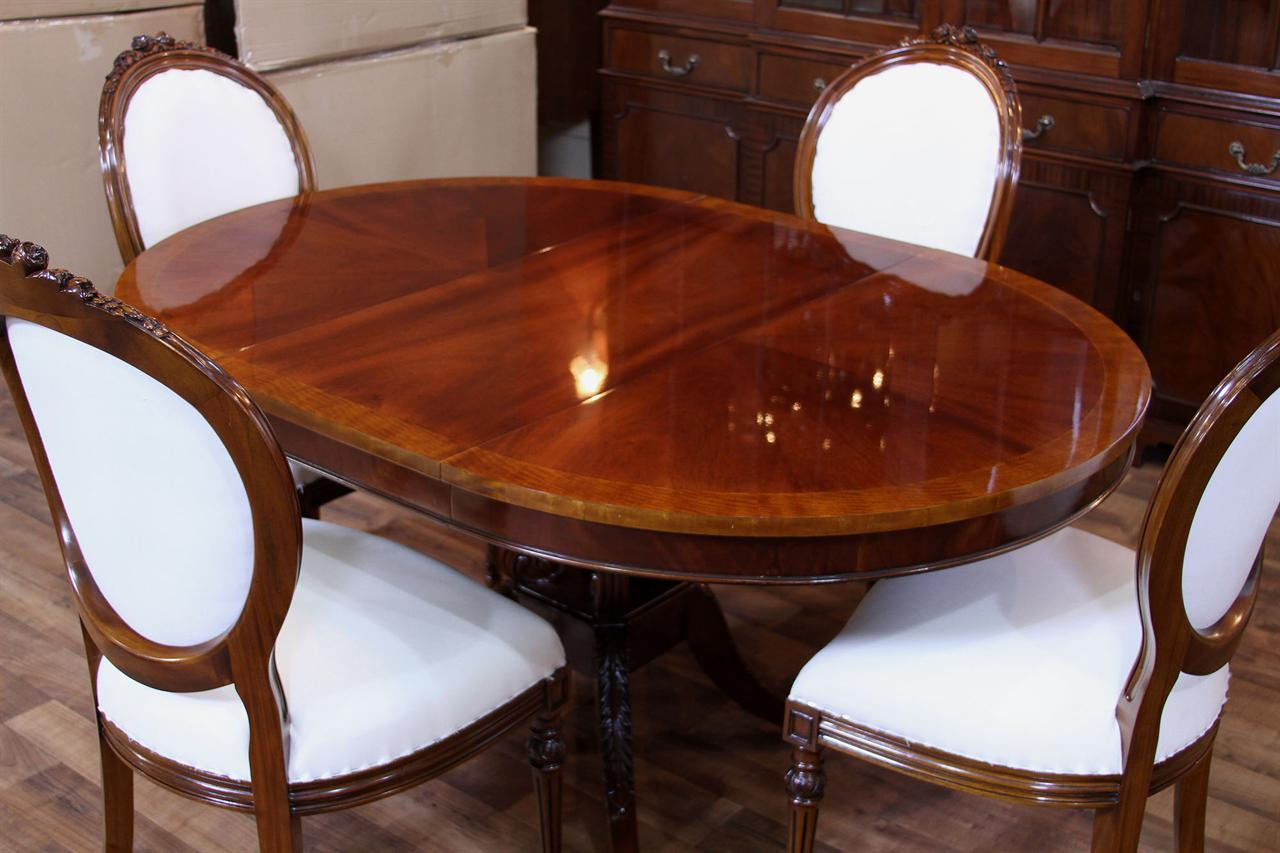 round back dining chairs shown with round mahogany dining table